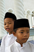 Moslem boys wait to attend friday prayers at the Omar Ali Saifuddien Mosque..Bandar Seri Bagwan, Brunei..Jeremy Horner
