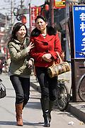 Women in the Yu Garden Bazaar, Shanghai, China