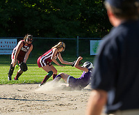 Caitlyn Shae of  Beckett Glass goes for the ball while Zoe Honigberg of Concord Ortho slides safely into second base during the Martel Cup Thursday evening at Dillon Field.   (Karen Bobotas/for the Concord Monitor)