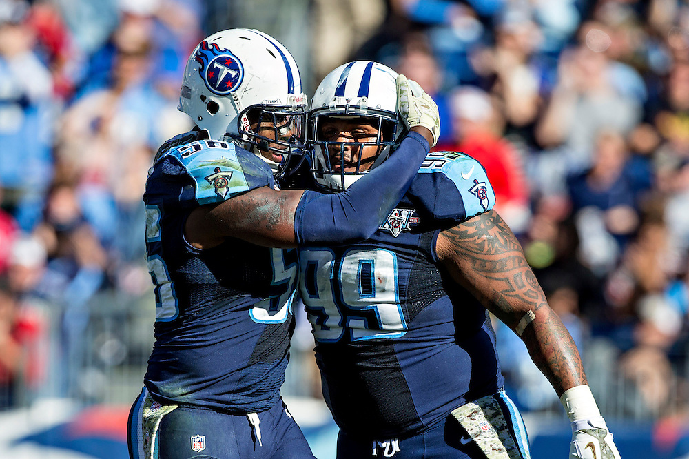 NASHVILLE, TN - NOVEMBER 10:  Jurrell Casey #99 and Akeem Ayers #56 of the Tennessee Titans celebrate after making a tackle against the Jacksonville Jaguars at LP Field on November 10, 2013 in Nashville, Tennessee.  The Jaguars defeated the Titans 29-27.  (Photo by Wesley Hitt/Getty Images) *** Local Caption *** Jurrell Casey; Akeem Ayers
