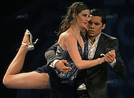 The Argentine couple of Micaela Minervino (L) and Jesus Taborda dance during the semifinal round of the Stage Tango competition at the Tango Dance World Championship in Buenos Aires on August 25, 2012.   AFP PHOTO / Alejandro PAGNI