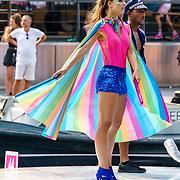 NLD/Amsterdam/20180604 - Gaypride 2018, danseres in een regenboog cape