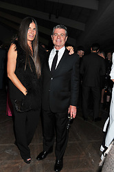 ELIZABETH SALTZMAN and Calvin Klein, Inc.'s President & CEO TOM MURRY  at a dinner hosted by Calvin Klein Collection to celebrate the future Home of The Design Museum at The Commonwealth Institute, Kensington, London on 13th October 2011.