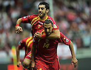Montenegro's Dejan Demianovic (R) and Milos Krkotic celebrate after Demianovic scored a goal during the FIFA World Cup 2014 group H qualifying football match of Poland vs Montenegro on September 6, 2013 in Warsaw, <br />