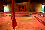 The Haida flag stands in the middle of a meeting room at the Haida Heritage Centre and museum near Skidegate, British Columbia.