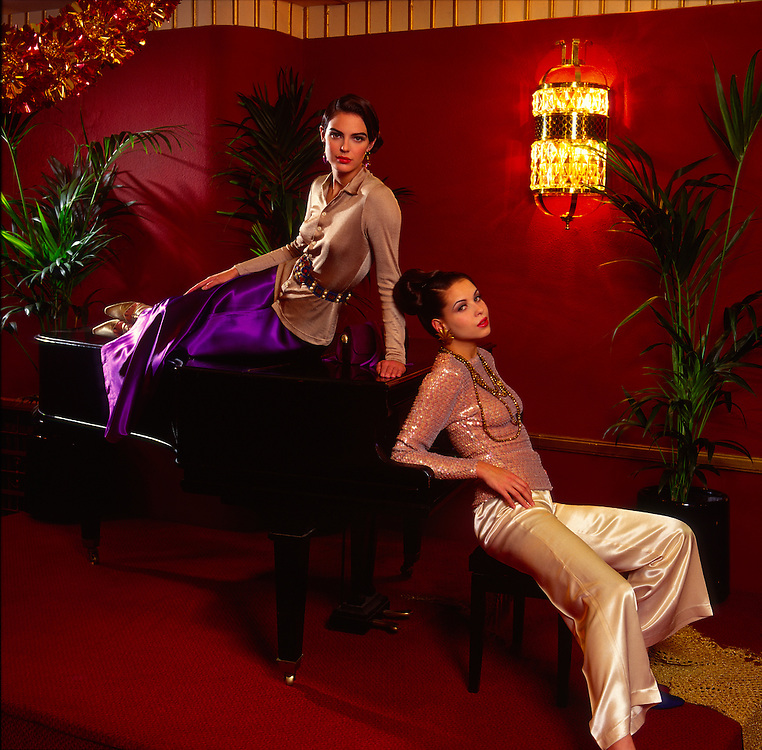 Two 1920's sultry girls on a piano