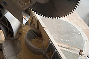close up of a circular saw with saw dust in a wood shop