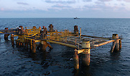 KEVIN BARTRAM/The Daily News.An El Paso Corporation offshore platform sits in about 200 feet of water 100 miles south of Galveston on Monday, June 27, 2005. The top half of the platform was cut off and placed onto the floor of the Gulf of Mexico near the base to form an artificial reef.