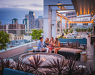 Friends having drinks on the Andaz Hotel Rooftop, San Diego, California Andaz Rooftop Lounge, San Diego, California
