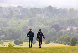 © Licensed to London News Pictures. 30/06/2020. Surrey, UK. Walkers brave the midsummer rain on Box Hill in the Surrey Hills as weather forecasters predict a mild but windy and wet week ahead for the South East. Photo credit: Alex Lentati/LNP