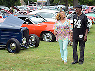 Renae McGahee, left, and John McQuilla of Levittown, Pennsylvania chat as they view the cars on display during the Morrisville Labor Day Picnic Monday September 5, 2016 at Williamson Park  in Morrisville, Pennsylvania. (Photo by William Thomas Cain)