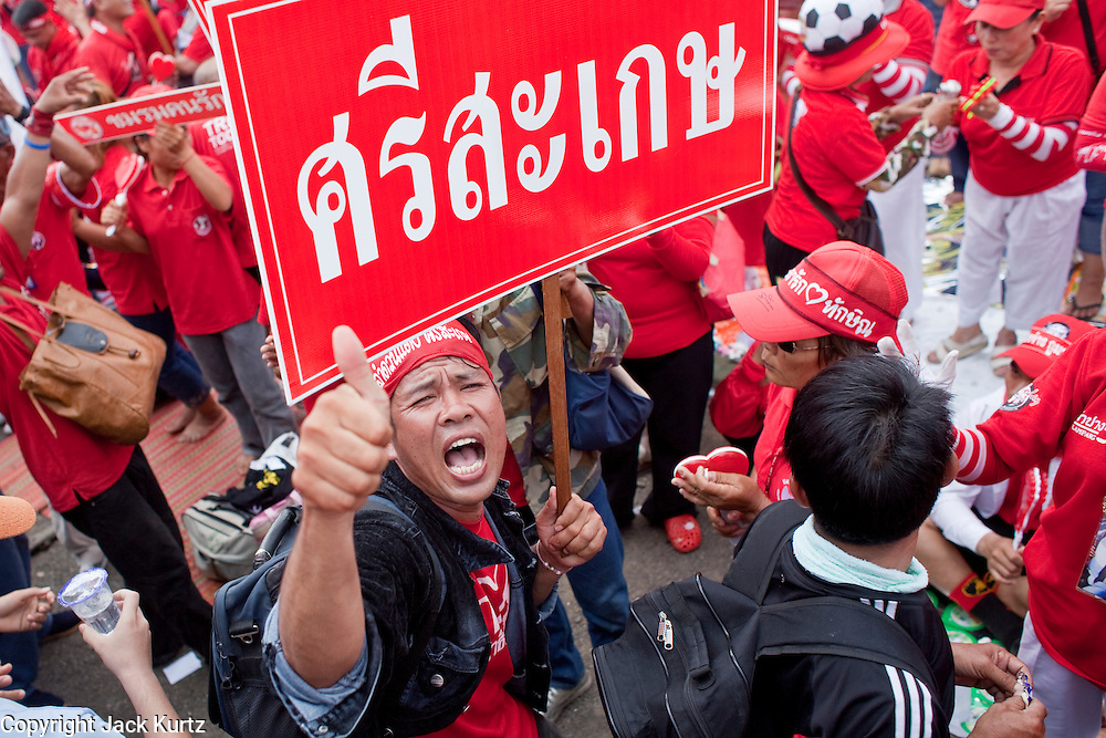 "Mar. 26, 2009 -- BANGKOK, THAILAND: People hold up signs at a protest of Red Shirts in Bangkok Thursday. More than 30,000 members of the United Front of Democracy Against Dictatorship (UDD), also known as the ""Red Shirts""  and their supporters descended on central Bangkok Thursday to protest against and demand the resignation of current Thai Prime Minister Abhisit Vejjajiva and his government. Abhisit was not at Government House Thursday. The protest is a continuation of protests the Red Shirts have been holding across Thailand in March.  Photo by Jack Kurtz"