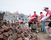 Volunteers clean up bricks off the back yard of The Dairy Arts Barn during Athens Beautification Day on Sunday, April 22th 2018.