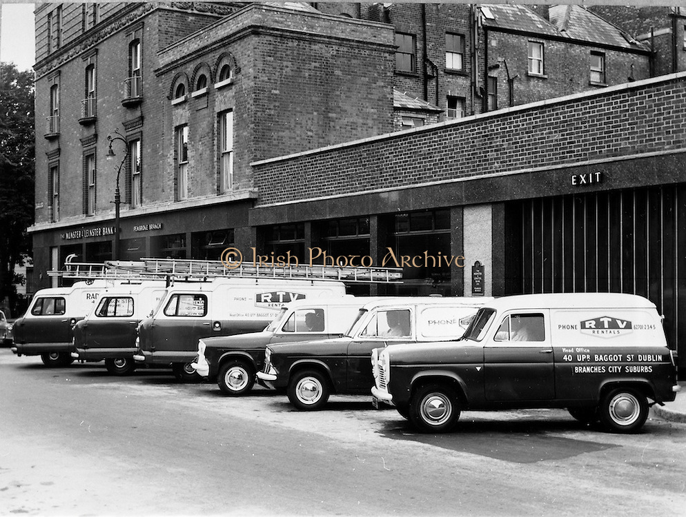 29/03/1963<br /> 03/29/1963<br /> 29 March 1963<br /> Copy (for Arrow)  of picture of RTV rentals motor fleet outside the Munster and Leinster Bank Pembroke branch 52 Upper Baggot Street, Dublin. RTV provided a rental television service until the company's final closure of its last three stores in 2006.