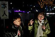 Tokyo, December 11 2012 - General election campaign by Mirai no To (Japan future party) leader Mrs Yukiko Kada (green jacket) supporting the independant candidate Taro Yamamoto in front of Asagaya station, Suginami ward.
