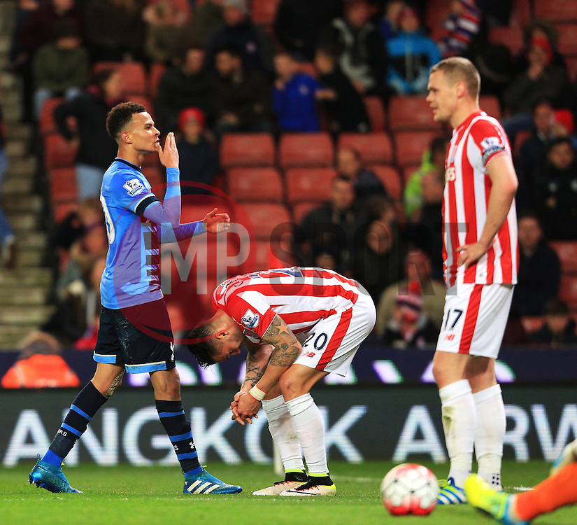 Dele Alli of Tottenham Hotspur celebrates after scoring his sides fourth goal amongst dejected Stoke players  - Mandatory by-line: Matt McNulty/JMP - 18/04/2016 - FOOTBALL - Britannia Stadium - Stoke, England - Stoke City v Tottenham Hotspur - Barclays Premier League