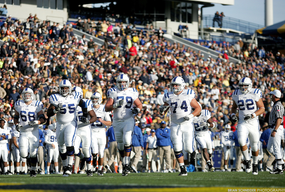 Oct 30, 2010; Annapolis, MD, USA; Duke Blue Devils offensive guard Brian Moore (68) and offensive guard Brandon Harper (55) and offensive tackle Kyle Hill (79) and offensive guard Dave Harding (74) and tight end Brandon King (22) run onto the field against the Navy Midshipmen during the first half at Navy-Marine Corp Memorial Stadium. Mandatory Credit: Brian Schneider-www.ebrianschneider.com
