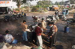 Street scene with scooters; bicycles; lorry and auto rickshaw and food stall by the side of the road in Chandigarh; Punjab; India,