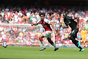 Arsenal forward Alex Iwobi (17) & West Ham United midfielder Cheikhou Kouyate (8) during the Premier League match between Arsenal and West Ham United at the Emirates Stadium, London, England on 22 April 2018. Picture by Bennett Dean.