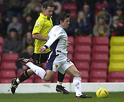28/02/2004  -  Nationwide Div 1 Watford v Wimbledon.Wimbledons Rob Gier passes, as Watfords Scott Fitzgerald challenges.