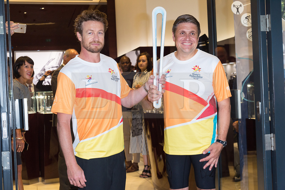 © Licensed to London News Pictures. 16/08/2017. London, UK. Longines Ambassador of Elegance Simon Baker (L) and Longines Vice President of Marketing Juan-Carlos Capelli ( R) hold The 2018 Commonwealth Games Queen's Baton at the Longines Botique in London. The Queen's Baton Relay began its journey in Buckingham Palace earlier this year and is now travelling through 71 nations or territories of the Commonwealth, covering 230'000 kilometres<br /> Photo credit: Ray Tang/LNP