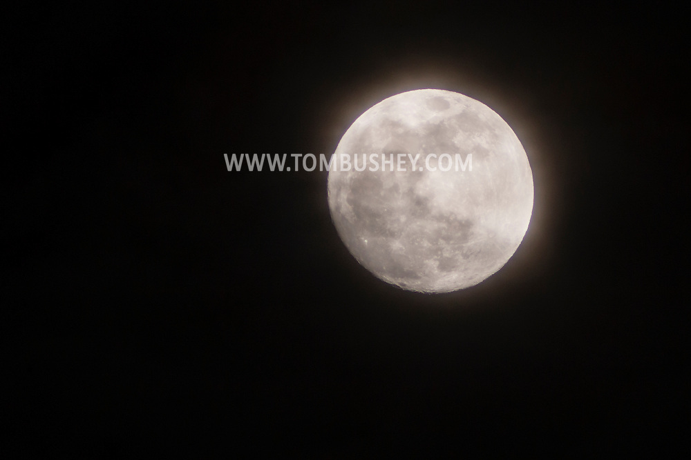 Middletown, New York - The moon and clouds on April 2, 2015. ©Tom Bushey / The Image Works