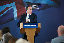 © Licensed to London News Pictures. 03/05/2015. Nuneaton, Warwickshire, UK. The Prime Minister David Cameron visited Ambleside sports club in Nuneaton, Warwickshire, earlier today. Pictured, David Cameron reaches for the letter left to him by the last Labour Government. Photo credit : Dave Warren/LNP