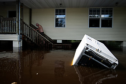 Resident checks property in Middleburg, Florida, USA, on September 12, 2017. Residential structures near Black Creek, Clay County, Florida are submerged by historic 28.5-foot flooding after Hurricane Irma took an unexpected turn and caused major damages in the region.