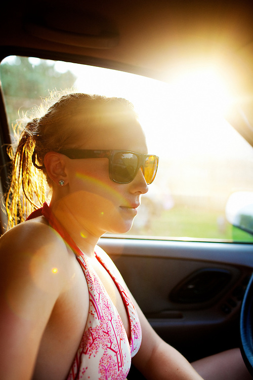 Melissa Eich, 23, drives from our campsite to the beach during family vacation on Ocracoke Island, North Carolina on Saturday, August 7, 2010.
