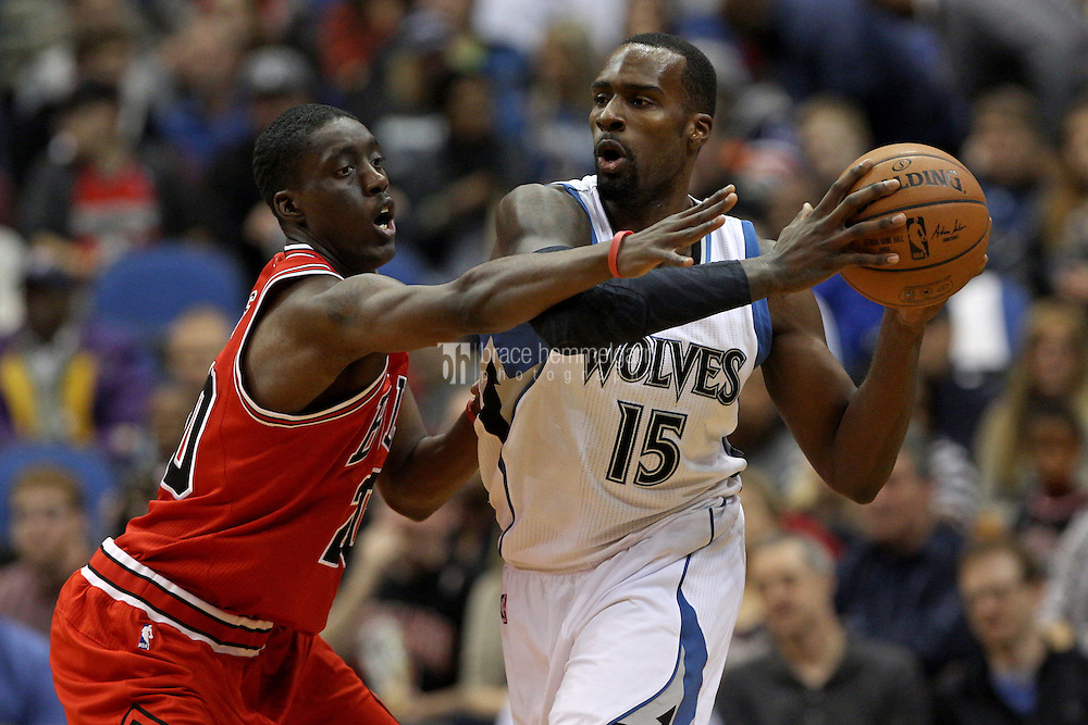 Nov 1, 2014; Minneapolis, MN, USA; Minnesota Timberwolves forward Shabazz Muhammad (15) attempts to pass around Chicago Bulls forward Tony Snell (20) during the second quarter at Target Center. Mandatory Credit: Brace Hemmelgarn-USA TODAY Sports