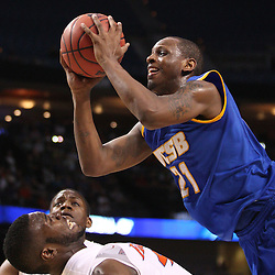 Mar 17, 2011; Tampa, FL, USA; UC Santa Barbara Gauchos forward James Nunnally (21) collides with Florida Gators forward/center Patric Young (4)during second half of the second round of the 2011 NCAA men's basketball tournament at the St. Pete Times Forum. Florida defeated UCSB 79-51.  Mandatory Credit: Derick E. Hingle