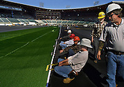 New turf is stretched into place by a crew at the soon to open PGE Park, formerly Civic Stadium in Portland.