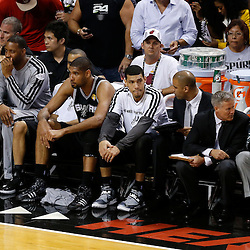 Jun 20, 2013; Miami, FL, USA; San Antonio Spurs power forward Tim Duncan (21) and Danny Green react on the bench against the Miami Heat during the first quarter of game seven in the 2013 NBA Finals at American Airlines Arena. Mandatory Credit: Derick E. Hingle-USA TODAY Sports