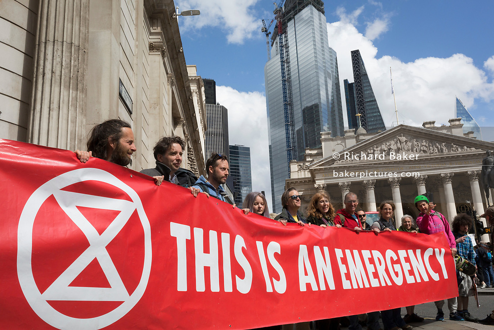 Environmental activists protest outside the Bak of England in the City of London on the 11th and final day of protests, road-blockages and arrests across London by the climate change campaign Extinction Rebellion, on 25th April 2019, in London, England.
