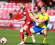Crawley Town striker Rhys Murphy, on loan from Oldam Athletic, shields the ball from Accrington Stanley defender Dean Winnard during the Sky Bet League 2 match between Crawley Town and Accrington Stanley at the Checkatrade.com Stadium, Crawley, England on 26 September 2015. Photo by Bennett Dean.
