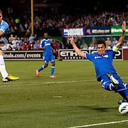 Manchester City's Edin Dzeko 10 shoots on goal as Chelsea's Paulo Ferreira 19 attempts to block him at Busch Stadium in St. Louis.