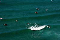 9 September 2009:  John Kissel memorial gathering northside at the Huntington Beach Pier. Over 150 surfers and friends gathered for a traditional surfers memorial service by paddling out on their boards and honoring their friend in the pacific ocean. Aerial photo from helicopter Bolsa Chica.