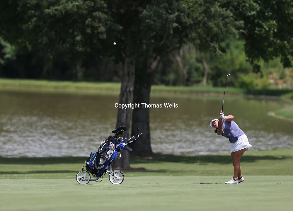 Riley Mayhew makes her approach shot on the 18th hole on Friday at the Tupleo Country Club.