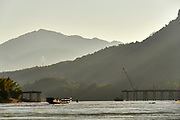 Laos, Luang Prabang Province. A new road bridge across the Mekong under construction, financed by China.