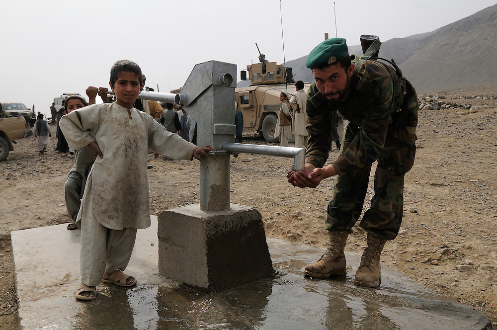 "An ANA soldier from 3rd Brigade, 201st Corps, drinks water from a new well during an operation in Tagab Valley.....Colonel Haynes said the battle plan, ""The creeping barrage of goodness,"" to win the hearts and minds of the Tagab Valley includes: a paved road, wells, radio stations, solar power, humanitarian aid, and medical outreach.  Agricultural development teaching how to package goods, and pruning techniques to increase crop yields.  Saffron cultivation started too, as a replacement to poppy.  More projects like schools and police checkpoints will follow as resources allow..."