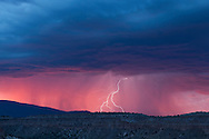 Rain storm with lightning at sunset over Otowi Mesa in the Pajarito Plateau on the east side of the Jemez Mountains, NM, © 2014 David A. Ponton