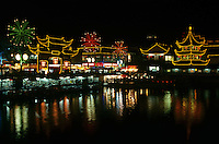 China Shanghai Yu Yuang Gardens the teahouse ancient shopping area and lake at night