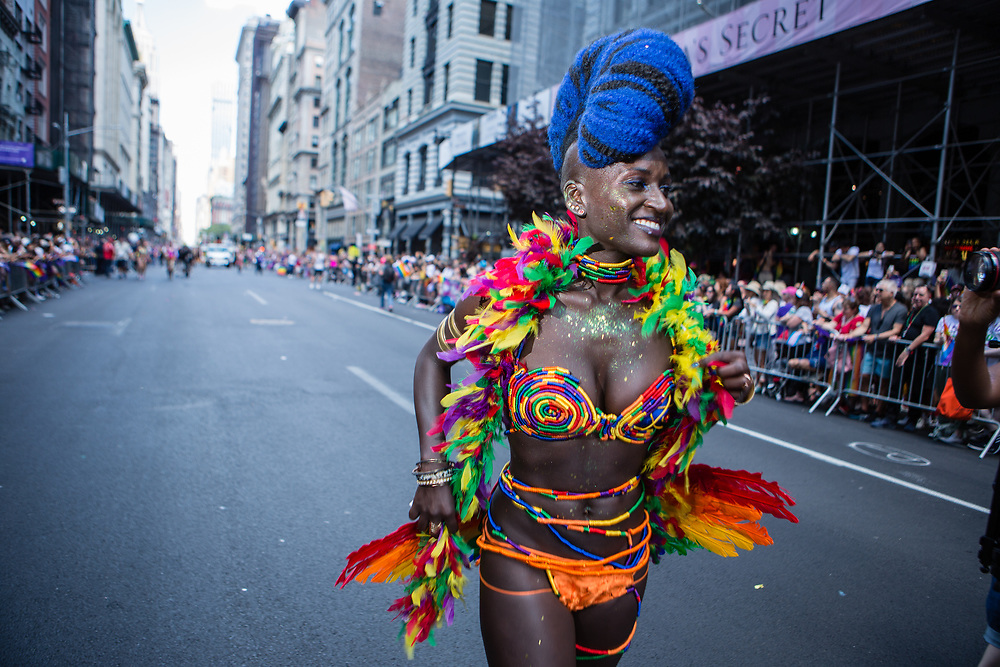 New York, NY - 30 June 2019. The New York City Heritage of Pride March filled Fifth Avenue for hours with participants from the LGBTQ community and it's supporters. A marcher in a bright feathered and beaded costume.