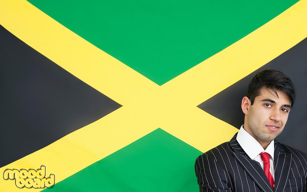 Portrait of a confident businessman against Jamaican flag
