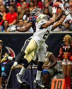 Aug 25, 2013; Houston, TX, USA; New Orleans Saints cornerback Patrick Robinson (21) breaks up a pass intended for Houston Texans wide receiver Keshawn Martin (82) during the first half at Reliant Stadium. Mandatory Credit: Thomas Campbell