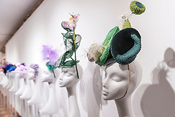 """© Licensed to London News Pictures. 05/04/2019. LONDON, UK. Hats on display at """"The Great Hat Exhibition - World Garden"""", which is taking place at the Menier Gallery near London Bridge until 12 April 2019, as part of London Hat Week.  150 international milliners have created 200 hats inspired by the colours, flowers, plants and landscapes from around the world.  The exhibition is curated by Monique Lee Millinery and supported by X Terrace, a fashion platform.  Photo credit: Stephen Chung/LNP"""