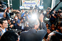 Presidential candidate Alvaro Colom, of the National Unity for Hope Party, waves as he prepares to vote Sunday Sept. 9, 2007, Guatemala City.   .......