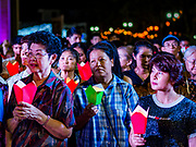 """23 DECEMBER 2018 - CHANTABURI, THAILAND: Women pray at the Cathedral of the Immaculate Conception's Christmas Fair in Chantaburi. Cathedral of the Immaculate Conception is holding its annual Christmas festival, this year called """"Sweet Christmas @ Chantaburi 2018"""". The Cathedral is the largest Catholic church in Thailand and was founded more than 300 years ago by Vietnamese Catholics who settled in Thailand, then Siam.   PHOTO BY JACK KURTZ"""