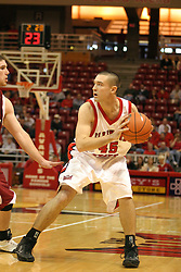 19 November 2005: Brandon Holtz plays keep away with a Hound while looking for a pass option. In a non-conference race that came down to a photo finish, the Illinois State Redbirds slipped past the Indianapolis University Greyhounds 54-50 at Redbird Arena in Normal Illinois