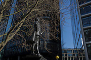 The statue of Member of parliament and Mayor John Wilkes (1727-1797) and modern corporate architecture in Fetter Lane, on 13th February 2017, in London, United Kingdom.